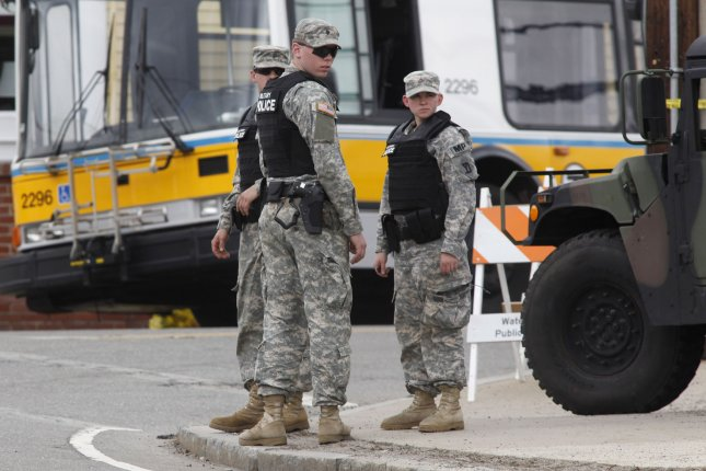 Army National Guardsmen stand by on School Street in Watertown, Massachusetts during a massive manhunt for one of the two Boston Marathon bombing suspects on April 19, 2013. Monday's Boston Marathon bombing left three dead and over 170 injured. UPI/Matthew Healey