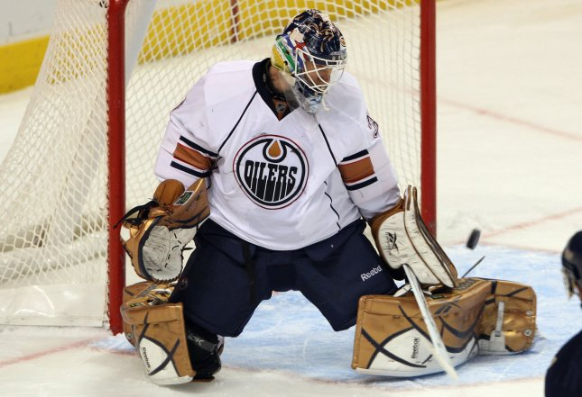 Edmonton Oilers goaltender Jeff Deslauriers knocks the puck wide during a game Dec. 11, 2009. UPI/Bill Greenblatt