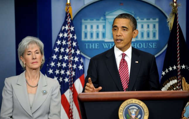 U.S. President Barack Obama announces a compromise and says the administration will not require religious institutions to pay for birth control for their employees, during remarks in the Brady Press Room at the White House in Washington DC on February 10, 2012. At left is Health and Human Services Secretary Kathleen Sebelius. UPI/Pat Benic...
