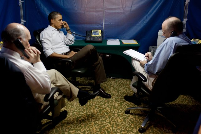 President Barack Obama is briefed on the situation in Libya during a secure conference call with National Security Advisor Tom Donilon, right, Chief of Staff Bill Daley, left, Secretary of State Hillary Clinton, Secretary of Defense Bob Gates, AFRICOM Commander General Carter Ham, and Deputy National Security Advisor Denis McDonough, in Rio de Janeiro, Brazil, Sunday, March 20, 2011. UPI/Pete Souza/White House