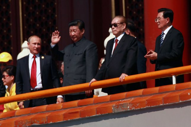 Left to right, Russian President Vladimir Putin, Chinese President Xi Jinping, former Chinese Presidents Jiang Zemin and Hu Jintao preside over a parade marking the 70th anniversary of victory over Japan held in September. On far left, South Korean President Park Geun-hye observes the parade. Park and Xi had agreed to work toward denuclearization on the Korean peninsula, but China is not responding to a call from South Korea. File Photo by Stephen Shaver/UPI