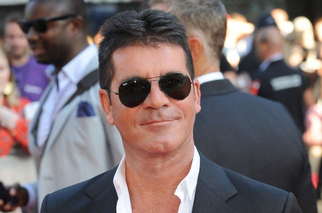 Simon Cowell at the London premiere of One Direction: This is Us on August 20, 2013. File Photo by Paul Treadway/UPI