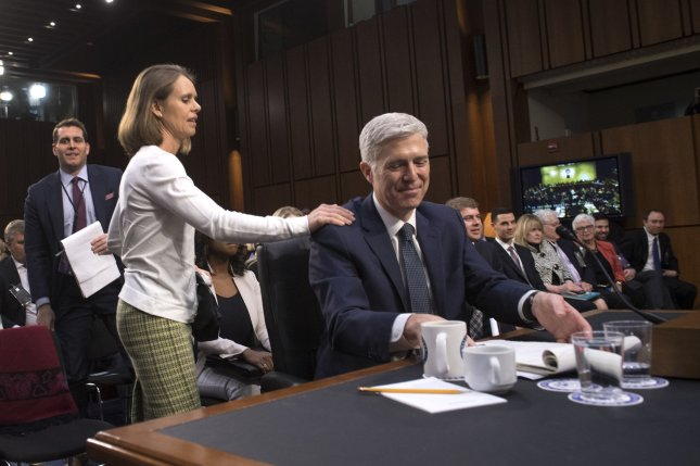 Supreme Court nominee Neil M. Gorsuch with his wife Marie Louise on the third day of his confirmation hearing before the Senate Judiciary Committee on Capitol Hill on Wednesday. Photo by Kevin Dietsch/UPI