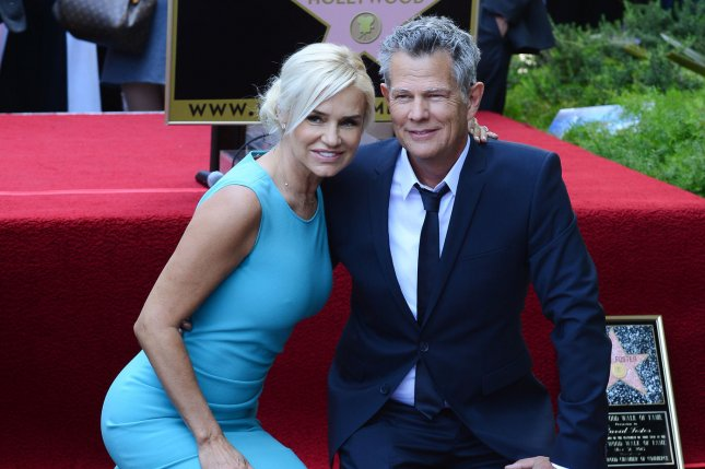 David Foster is joined by his wife Yolanda Hadid during an unveiling ceremony, honoring him with the 2,499th star on the Hollywood Walk of Fame in Los Angeles on May 31, 2013. Hadid is to star in a new reality series for Lifetime. File Photo by Jim Ruymen/UPI