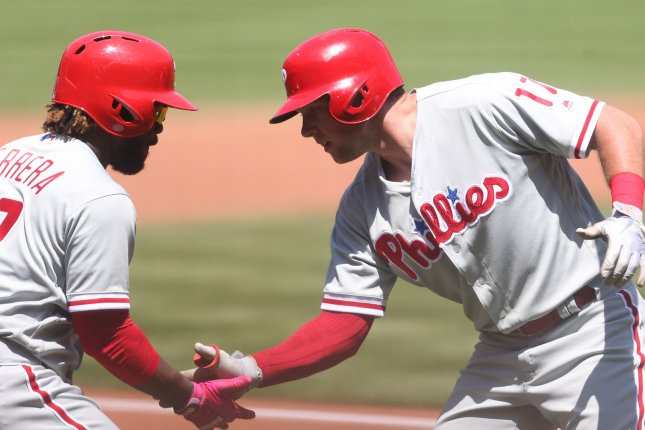 Philadelphia Phillies' Odubel Herrera (L) shakes hands with Rhys Hoskins after Hoskins hit a solo home run in the fourth inning against the St. Louis Cardinals on May 20 at Busch Stadium in St. Louis. Photo by Bill Greenblatt/UPI
