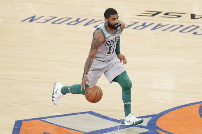 Boston Celtics point guard Kyrie Irving brings the basketball up the court in the first half against the New York Knicks on February 24, 2018 at Madison Square Garden in New York City. Photo by John Angelillo/UPI