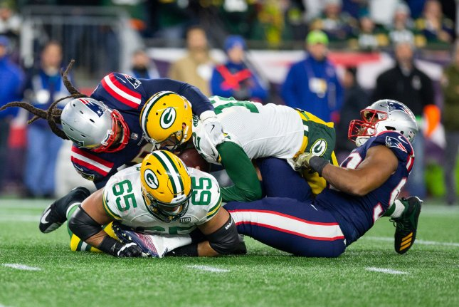 Green Bay Packers quarterback Aaron Rodgers (12) is sacked by New England Patriots defensive ends Adrian Clayborn (94) and Trey Flowers (98) in the fourth quarter on November 4, 2018 at Gillette Stadium in Foxborough, Massachusetts. Photo by Matthew Healey/UPI
