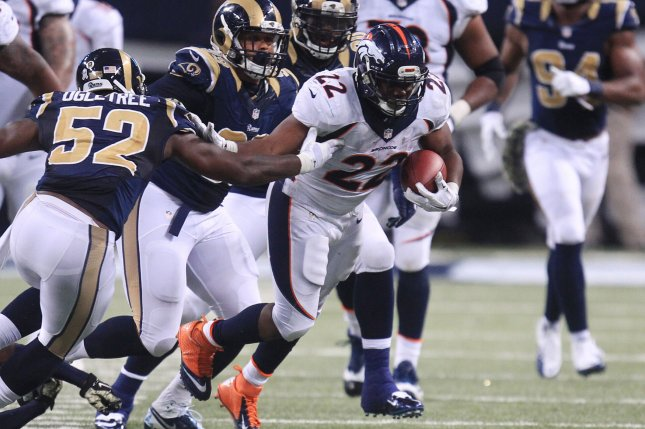 Former Denver Broncos running back C.J. Anderson (22) breaks a tackle late in the fourth quarter on November 16, 2014 at the Edward Jones Dome in St. Louis. File photo by Bill Greenblatt/UPI