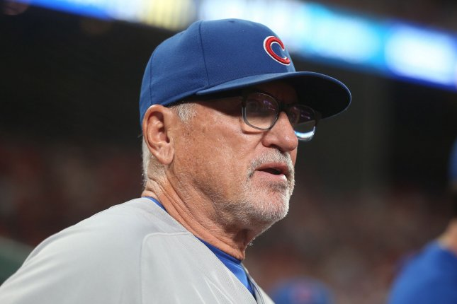Chicago Cubs manager Joe Maddon watches the last out of an 8-6 victory Saturday over the host St. Louis Cardinals at Busch Stadium. Before season finale Sunday, the Cubs announced they were parting ways. Photo by BIll Greenblatt/UPI