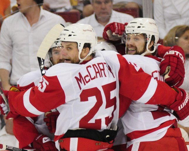 Detroit Red Wings Darren McCarty and teammates swarm Jiri Hudler after the game wining goal against the Pittsburgh Penguins in the third period of game four of the 2008 Stanley Cup Finals at the Mellon Arena in Pittsburgh on May 31, 2008. (UPI Photo/Archie Carpenter)