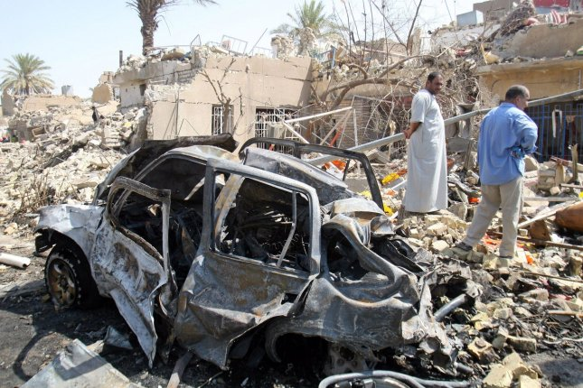 A burned out car is seen among rubble at the site of a bombing in Baghdad, Iraq, August 25, 2010. UPI/Photo