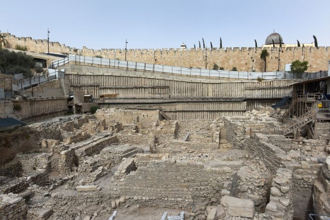 An overview of an excavation area at the City of David Archeology Park outside the Old City of Jerusalem, near the East Jerusalem neighborhood of Silwan, November 3, 2015. According to the Israel Antiquities Authority, after years of excavations underneath the Givati parking lot, the remains of a stronghold, the Acra, used by the Greeks more than 2,000 years ago to control the Temple Mount during the reign of King Antiochus Epiphanes (c. 215-164 BCE) were discovered at the excavation site. Archeological findings of sling stones, arrowheads, and ballistas stones were recovered and are evidence of the Hasmonean attempts to conquer the stronghold. Photo by Debbie Hill/ UPI