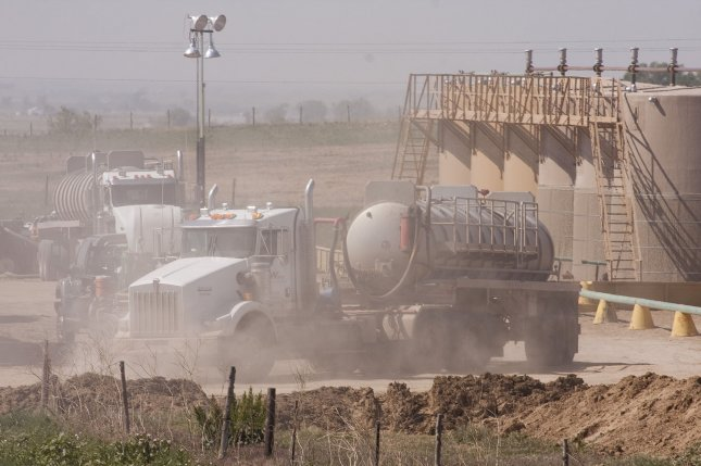 There was no apparent damage to regional pipeline infrastructure after a cluster of seismic events recorded near key U.S. oil storage depot in Oklahoma. Pictured, water trucks depart a 4.5 million gallon storage facility. It takes large amounts of water to obtain shale oil and gas in a process called hydraulic fracturing or fracking, and recent seismic events have been linked with the injection disposal of wastewater. File photo by Gary C. Caskey/UPI
