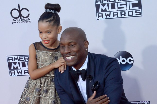 Tyrese Gibson (R) and daughter Shayla attend the American Music Awards on November 22, 2015. The actor announced Tuesday that he tied the knot in February. File Photo by Jim Ruymen/UPI