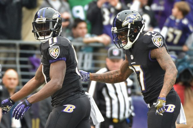 Baltimore Ravens wide receiver Kamar Aiken (11) and Mike Wallace (17) celebrate Aiken's touchdown against the Philadelphia Eagles on a five-yard pass during the first half of their NFL game at M&T Bank Stadium in Baltimore, Maryland, December 18, 2016. Photo by David Tulis/UPI