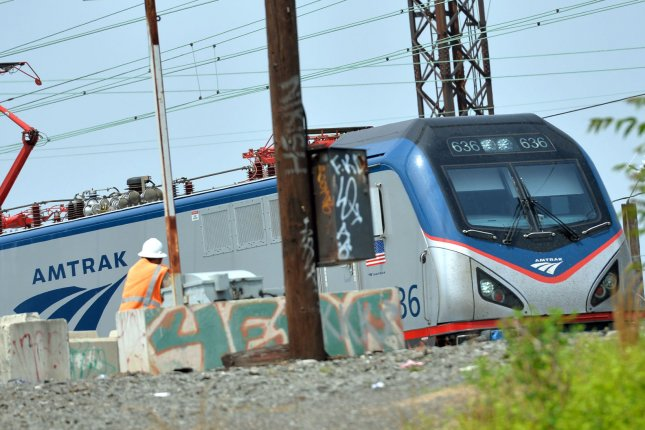 An Amtrak train travels in Philadelphia in 2015. An Amtrak train struck and killed two people in Washington, D.C., and injured a third person. File Photo by Kevin Dietsch/UPI