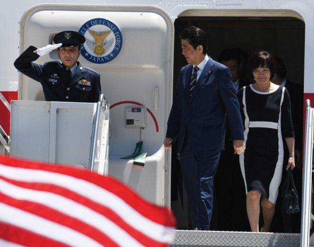 Japanese Prime Minister Shinzo Abe and his wife Akie Abe arrive at West Palm Beach Airport in Florida on Tuesday. Abe will meet with President Donald Trump at Mar-a-Lago. Photo by Gary I Rothstein/UPI