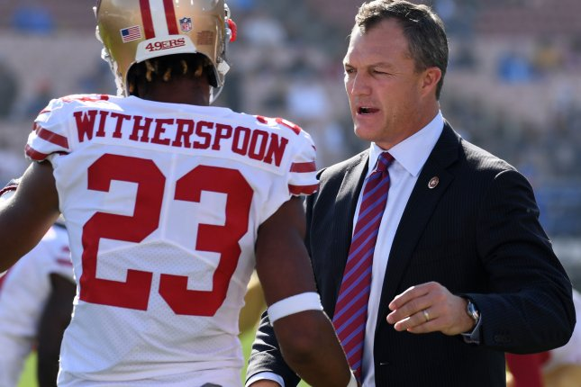 San Francisco 49ers general manager John Lynch embraces Ahkello Witherspoon prior to game against the Rams on December 31 in Los Angeles. Photo by Jon SooHoo/UPI