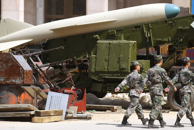 Chinese soldiers march past a mobile rocket launcher on display at the Chinese Military Museum of the People's Revolution in Beijing. File Photo by Stephen Shaver/UPI
