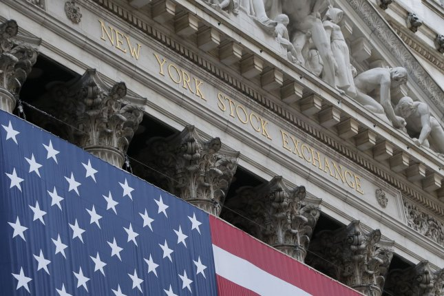 An American Flag hangs outside of the New York Stock Exchange on Wall Street in New York City on March 18. The Dow climbed more than 1,5600 points at the end of trading Monday. Photo by John Angelillo/UPI