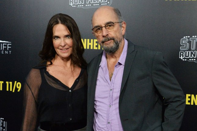 Richard Schiff (R), pictured with Sheila Kelley, gave an update after testing positive for COVID-19. File Photo by Jim Ruymen/UPI