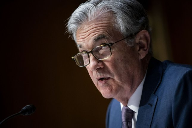 The Dow Jones Industrial Average fell 345 points on Thursday after Federal Reserve Chair Jerome Powell said the central bank would remain patient in regards to policy changes combatting rising inflation. File Pool Photo by Al Drago/UPI