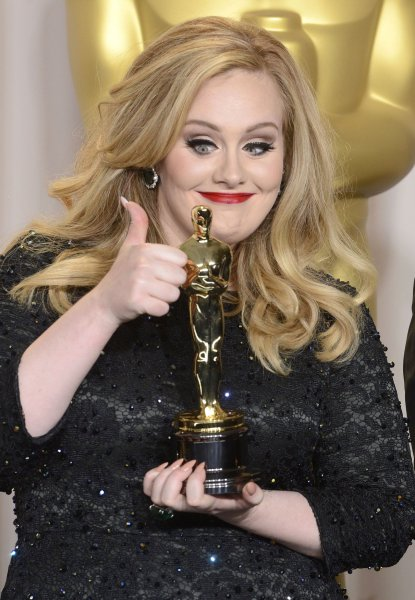 Adele Adkins pose with her Oscars for Achievement in Music (Original Song) for Skyfall backstage at the 85th Academy Awards at the Hollywood and Highlands Center in the Hollywood section of Los Angeles on February 24, 2013. UPI/Phil McCarten