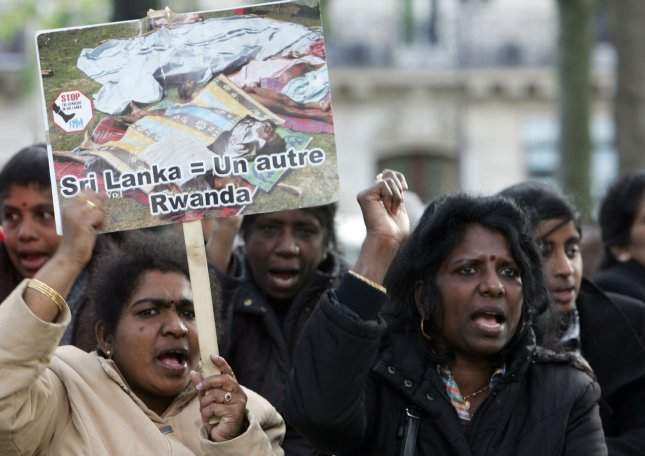 Tamils hold placards and chant slogans as they demonstrate in Paris to call for a ceasefire in Sri Lanka and the immediate intervention of the international community.