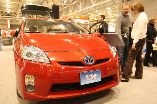 Visitors to the 2010 St. Louis Auto Show look at the new Toyota Prius at the Edward Jones Dome and America's Center in St. Louis on January 29, 2010. Toyota announced earlier this week that the Prius and seven other models have accelerators that could become stuck. Toyota stopped selling the eight U.S. models and also announced that it will stop building them until the problem is fixed. The automaker blamed the problem on condensation in the pedal assembly, which includes the pedal, a arm that goes into the engine compartment, and springs that send the pedal back to its resting position when the driver takes their foot off the gas pedal. The automaker says 4.2 million vehicles worldwide, 2.3 million of them in the U.S have the pedal problem. UPI/Bill Greenblatt