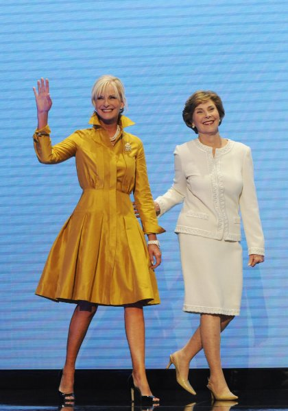 First Lady Laura Bush (R) and Cindy McCain, wife of Republican Presidential candidate Sen. John McCain (R-AZ), take the stage to speak on the first day of the Republican National Convention at the Xcel Energy Center in St. Paul, Minnesota on September 1, 2008. The Republican National Convention is proceeding with an abbreviated session today, only meeting for official business, due to Hurricane Gustav which is currently making landfall in Louisiana. (UPI Photo/Alexis C. Glenn)