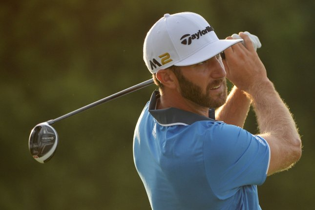 Dustin Johnson hits a tee shot on the 10th hole in the 3rd round of the U.S. Open at Oakmont Country Club near Pittsburgh, Pennsylvania on June 18, 2016. Photo by Kevin Dietsch/UPI