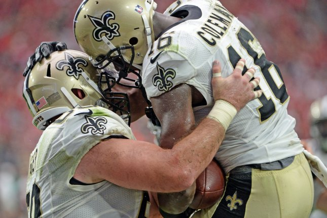 New Orleans Saints wide receiver Brandon Coleman (R) celebrates his touchdown with teammate center Max Unger in a game from 2015. Unger will start the season on the physically unable to perform list with a foot injury. File photo by Art Foxall/UPI