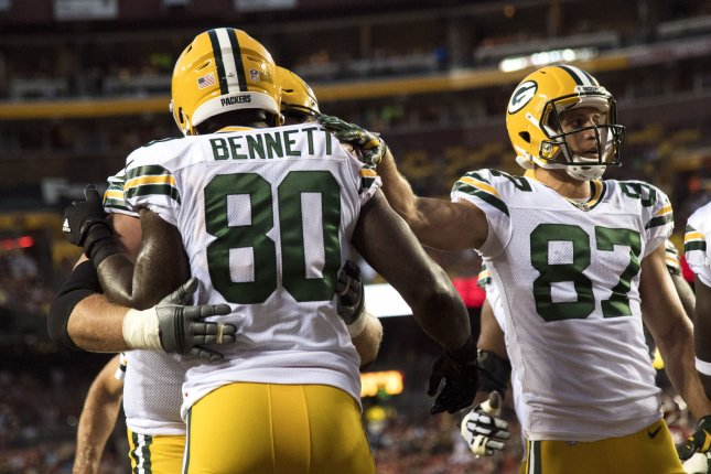 Green Bay Packers TE Martellus Bennett is congratulated by teammates after scoring a touchdown against Washington Redskins in the first quarter of their pre-season game on August 19 at FedEx Field in Landover, Md. Photo by Kevin Dietsch/UPI