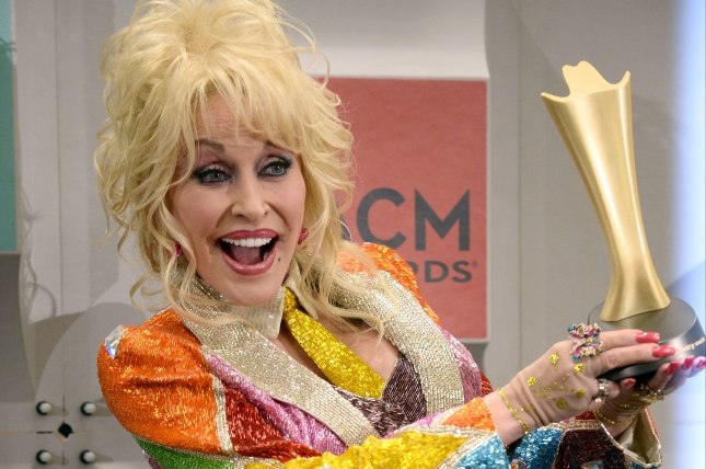 Dolly Parton holds her Tex Ritter award backstage at the 51st annual Academy of Country Music Awards held at the MGM Grand Arena in Las Vegas on April 3, 2016. The singer turns 72 on January 19. File Photo by Jim Ruymen/UPI
