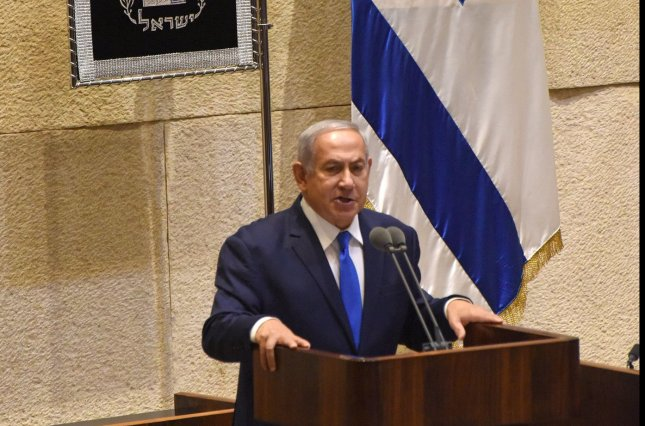 Israeli Prime Minister Benjamin Netanyahu speaks Monday at the opening session of the Knesset in Jerusalem, Israel. Netanyahu said he supports a possible move of Australia's Embassy to Jerusalem. Photo by Debbie Hill /UPI