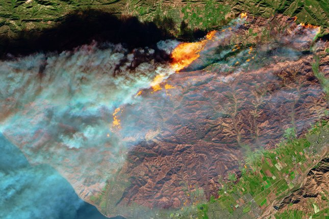 New research suggests wildfire ash can bind with and trap mercury released during burning, preventing it from being absorbed into local waterways. Photo by NASA/UPI