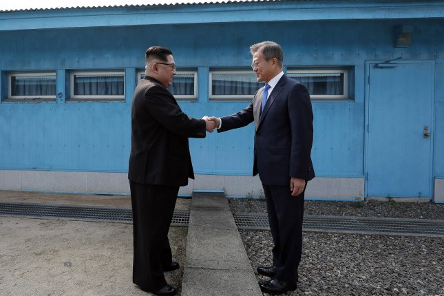 South Korean President Moon Jae-in (R) could push forward with North Korea initiatives this year, a former presidential aide to Moon said in an article published Thursday. Photo by Inter-Korean Summit Press Corps/UPI