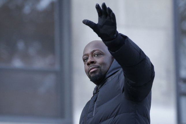 Wyclef Jean stands on a float on the parade route at the 91st Macy's Thanksgiving Day Parade in New York City on November 23, 2017. The musician turns 50 on October 17. File Photo by John Angelillo/UPI