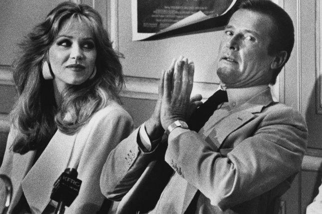 A View to a Kill co-stars Tanya Roberts (L) and Roger Moore hold a press conference in San Francisco in 1985. Roberts died Sunday at the age of 65. File Photo by Lloyd Francis/UPI