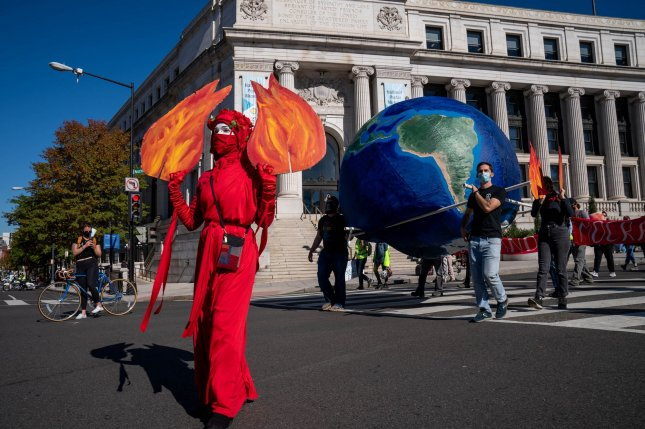 Protesters march to call attention to democracy and climate change in Washington, D.C. on November 4. File Photo by Ken Cedeno/UPI
