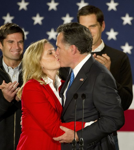 Republican presidential hopeful Mitt Romney (R) kisses his wife Ann at a caucus night rally on January 3, 2012 in Des Moines, Iowa. With 98 percent reporting, the caucus was a virtual tie between Romney and Rick Santorum. UPI/Brian Kersey