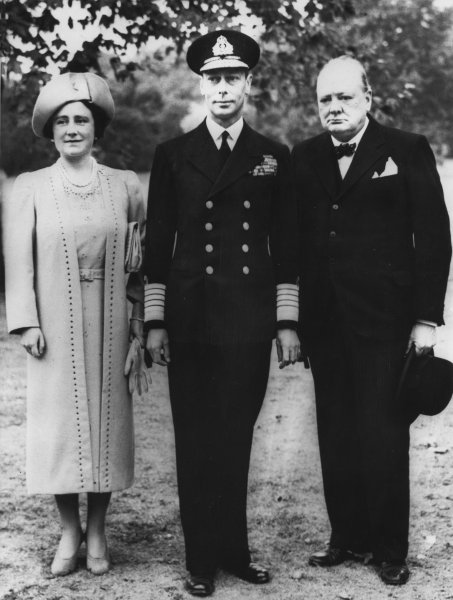 Britain's King George VI and Queen Elizabeth (the Queen Mother), accompanied by Prime Minister Winston Churchill, tour the grounds of Buckingham Palace on September 14, 1940, to inspect damage caused by German bombs that fell there. UPI File photo