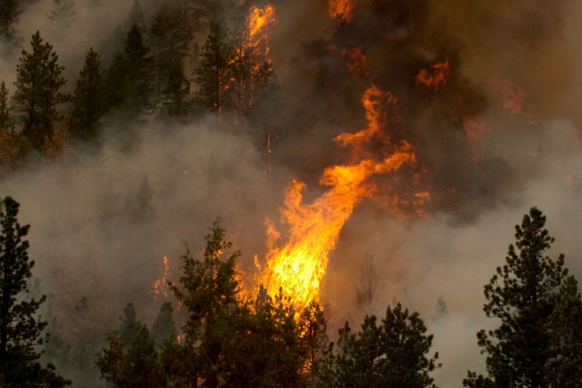 A wildfire burning in Colorado (File/UPI/Jess Geffre/Colorado National Guard)