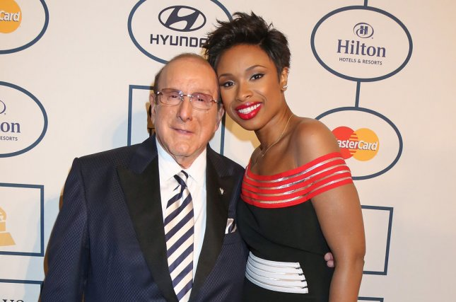 Clive Davis (L) and Jennifer Hudson arrive on the red carpet before the annual Clive Davis Pre-Grammy Gala in Beverly Hills, California on January 25, 2014. UPI/David Silpa