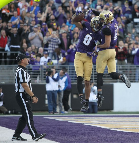 Washington Huskies wide receiver Dante Pettis (8) celebrates with Huskies wide receiver Aaron Fuller (12) after catching his second touchdown pass of the game in the third quarter at Husky Stadium October 22, 2016 in Seattle. Pettis caught 4 passes for 112 yards and scored two touchdown in the Huskies 41-17 win over the Beavers. Photo by Jim Bryant/UPI