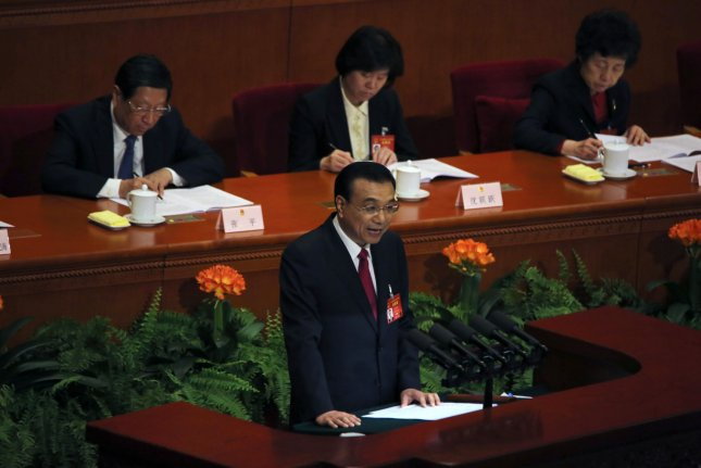 Chinese Premier Li Keqiang delivers a speech to China's top leaders and officials during the opening of the fifth session of the 12th National People's Congress at the Great Hall of the People in Beijing on Sunday. Photo by Stephen Shaver/UPI