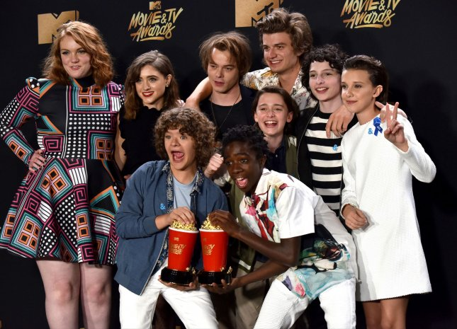 Cast of 'Stranger Things' appear backstage with the Show Of The Year award for 'Stranger Things' during the MTV Movie & TV Awards at the Shrine Auditorium in Los Angeles on May 7. It will be the 26th edition of the awards, and will for the first time present honors for work in television as well as cinema. Photo by Christine Chew/UPI