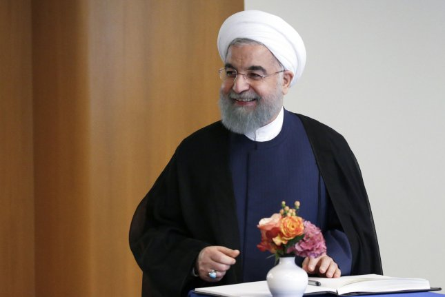 Iran's economy under President Hassan Rouhani is aligning with the rest of the world, but a Central Bank official said there still is risk. File photo by John Angelillo/UPI