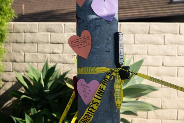 Written messages on hearts are taped to a post across the street from Chabad of Poway Synagogue in Poway, California on April 27, 2019. The accused gunman was charged with 109 hate crimes, the Justice Department announced Thursday. Photo by Ariana Drehsler/UPI