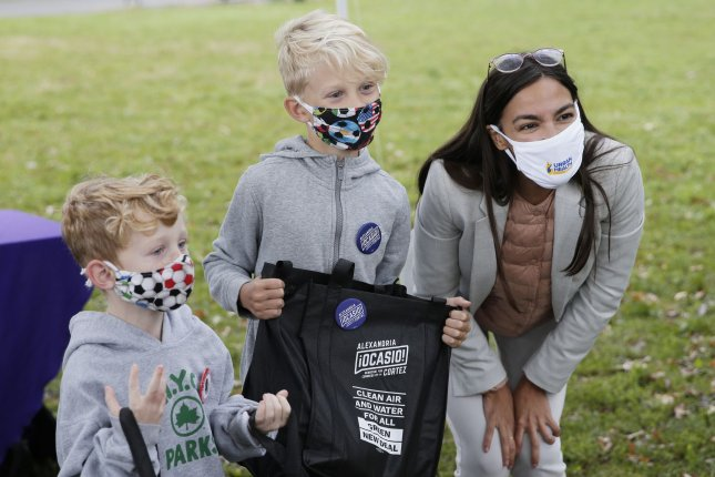 Rep. Alexandria Ocasio-Cortez, D-N.Y., wears a mask as she speaks with children at a community event Wednesday in New York City. Photo by John Angelillo/UPI